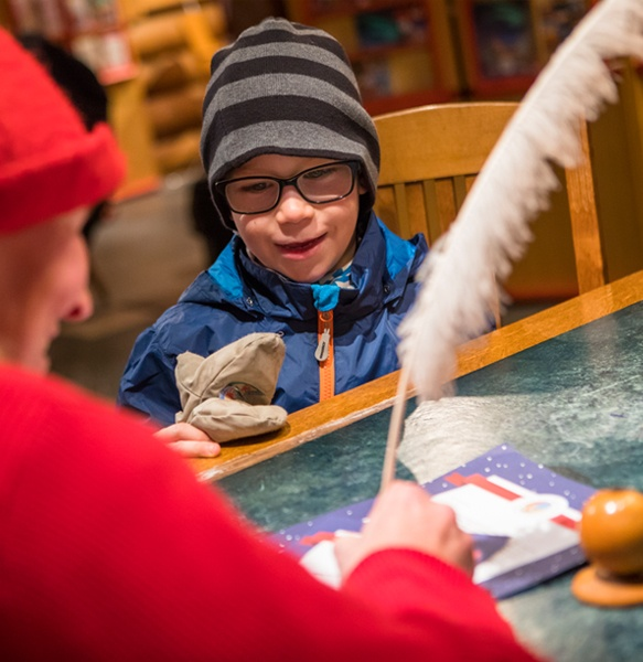 The elves at Santa Claus' main post office answer children's questions about Christmas.
